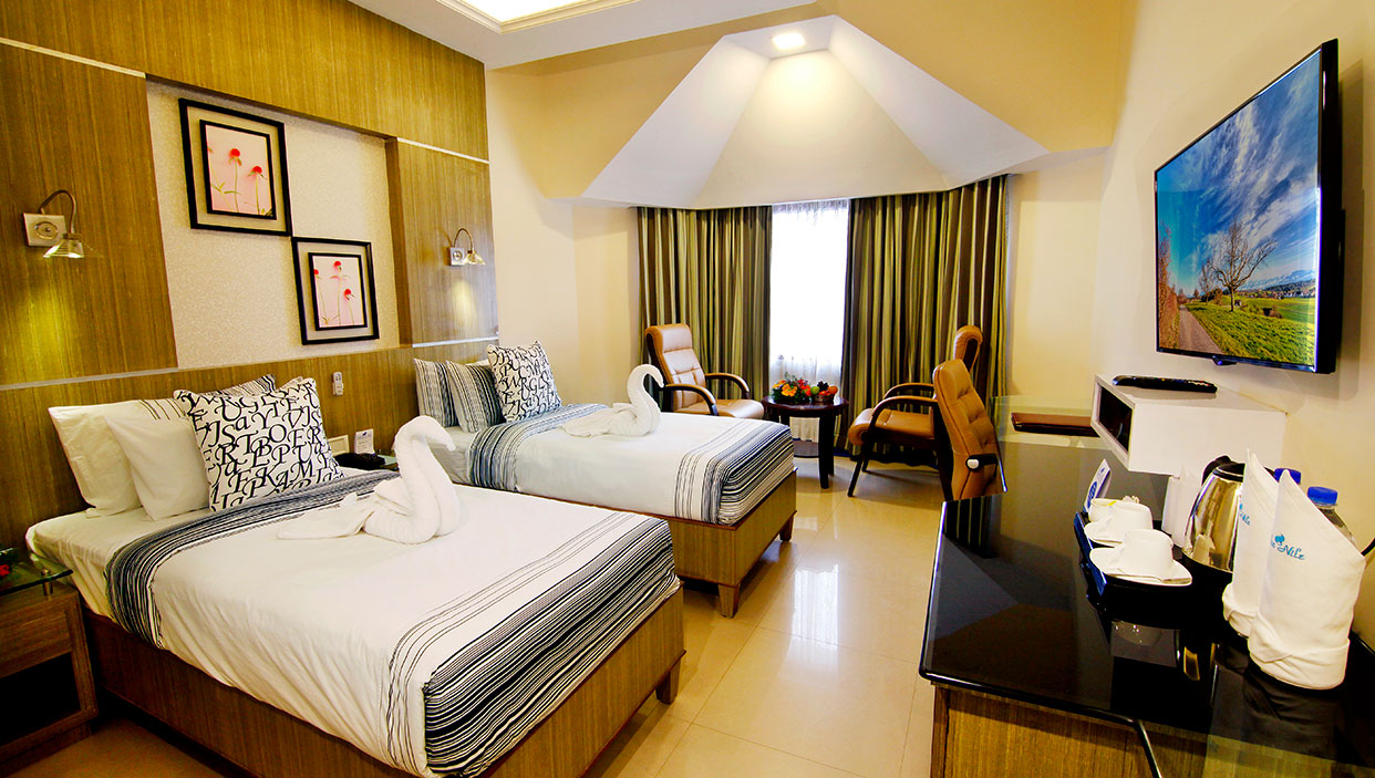 Budget hotel rooms in kannur